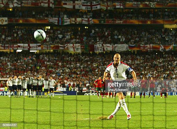 David Beckham of England kicks the ball over the bar during the UEFA Euro 2004 Quarter Final match between Portugal and England at the Luz Stadium on...