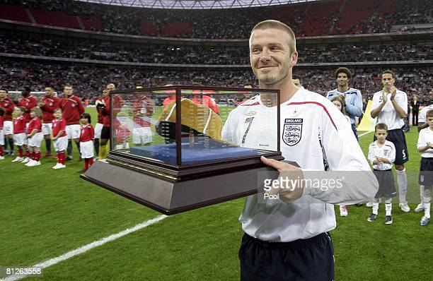 David Beckham of England receives his 100th cap before the International Friendly match between England and USA at Wembley Stadium on May 28 2008 in...