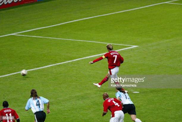 David Beckham of England scores a penalty during the Group F match against Argentina at the World Cup Group Stage played at the Sapporo Dome Sapporo...