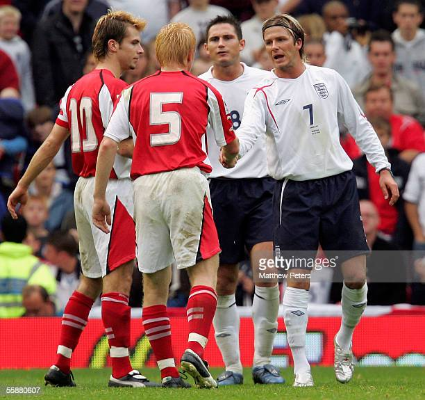 David Beckham of England shakes hands with Andreas Ibertsberger of Austria after being sent off during the World Cup qualifying match between England...