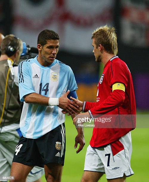 David Beckham of England shakes hands with Diego Simeone of Argentina after the England v Argentina Group F World Cup Group Stage match played at the...