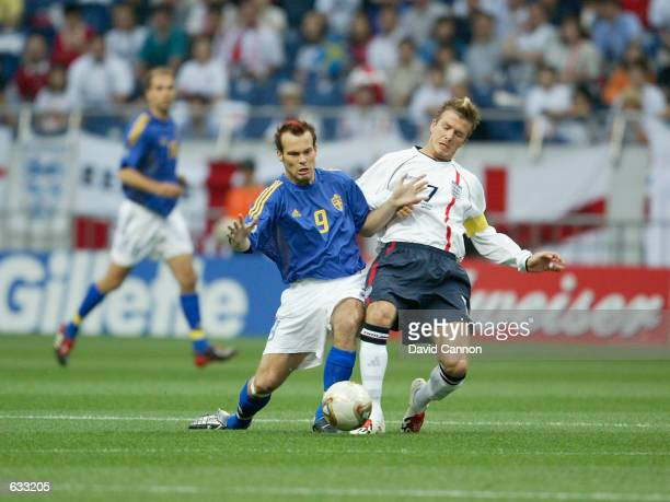 David Beckham of England tackles Fredrik Ljunberg of Sweden in the first half of the England v Sweden, Group F, World Cup Group Stage match played at...