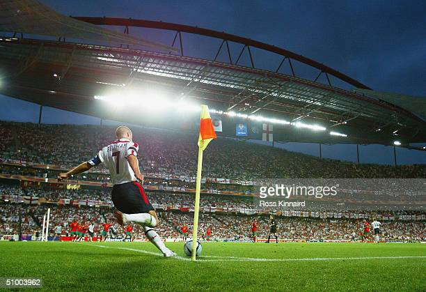 David Beckham of England takes a corner during the UEFA Euro 2004 Quarter Final match between Portugal and England at the Luz Stadium on June 24,...
