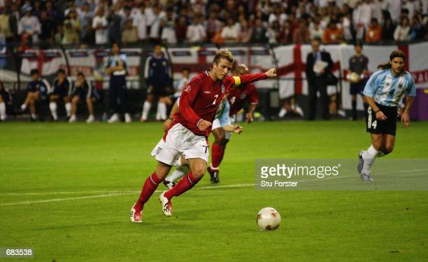 David Beckham of England takes the winning penalty after Michael Owen was brought down during the England v Argentina Group F World Cup Group Stage...