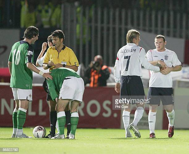 David Beckham of England talks to team mate Wayne Rooney during the World Cup Qualifier Group six match in Northern Ireland at Windsor Park on...