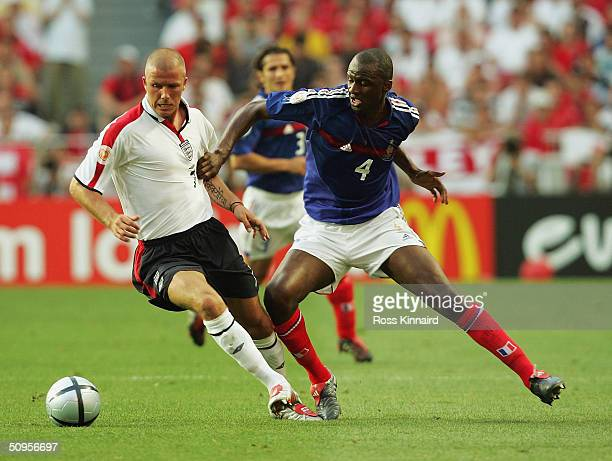 David Beckham of England turns away from Patrick Vieira of France during the France v England Group B match in the 2004 UEFA European Football...