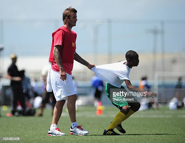 David Beckham of LA Galaxy plays a match with Young Children during a Coaching Clinic for local players at the Marvin Lee Stadium on September 26...