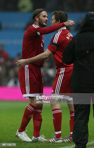 David Beckham of Great Britain and Ireland is replaced by his son Brooklyn Beckham during the David Beckham Match for Children in aid of UNICEF...