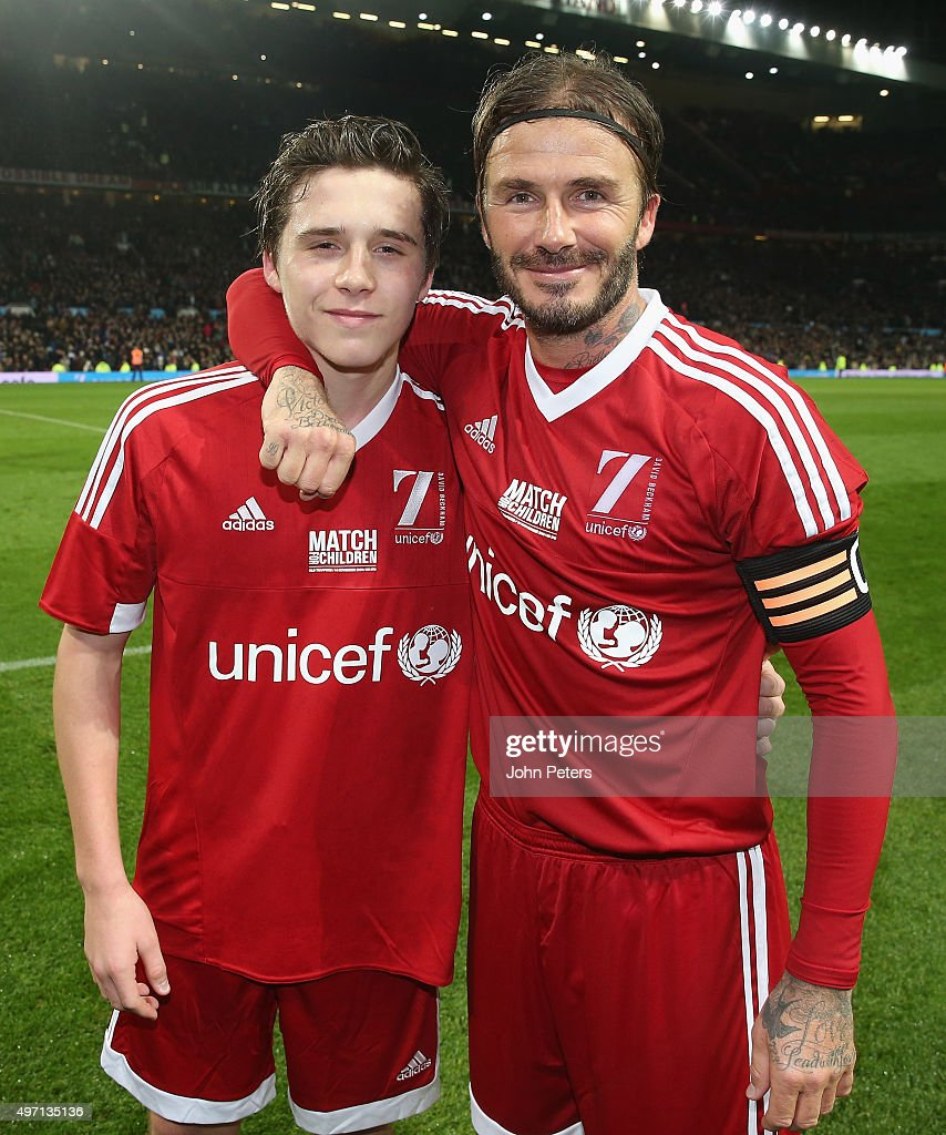 David Beckham of Great Britain and Ireland poses with his son Brooklyn Beckham after the David Beckham Match for Children in aid of UNICEF between Great Britain and Ireland and the Rest of the World at Old Trafford on November 14, 2015 in Manchester, England.