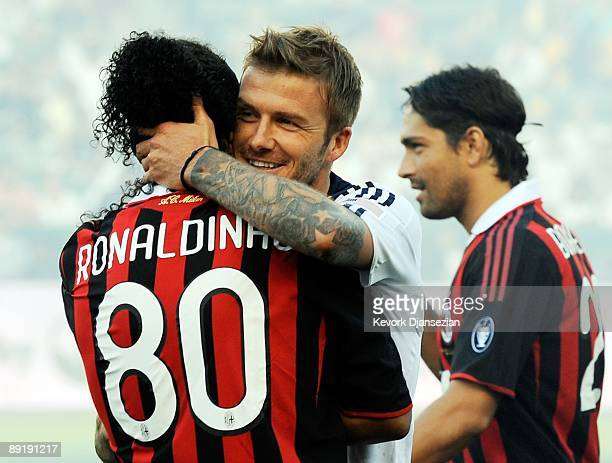 David Beckham of Los Angeles Galaxy and Ronaldinho of AC Milan hug before their friendly soccer match at The Home Depot Center on July 19 2009 in...
