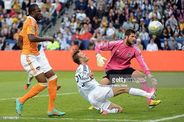 David Beckham of Los Angeles Galaxy attempts a shot on goalie Tally Hall of Houston Dynamo in the second half in the 2012 MLS Cup at The Home Depot...