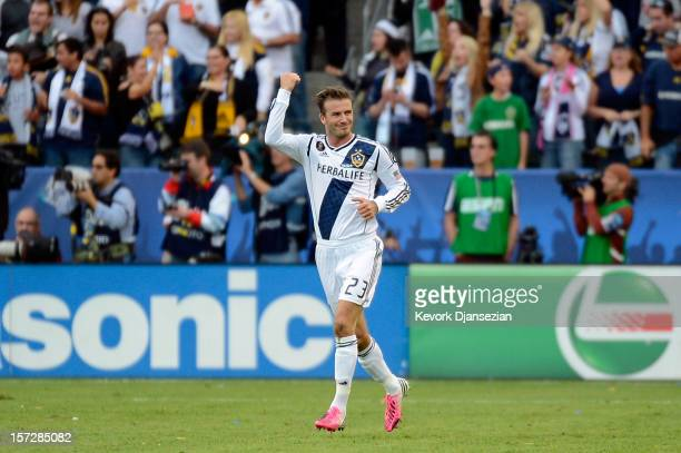 David Beckham of Los Angeles Galaxy celebrates after teammate Omar Gonzalez scores a second half goal against the Houston Dynamo in the 2012 MLS Cup...