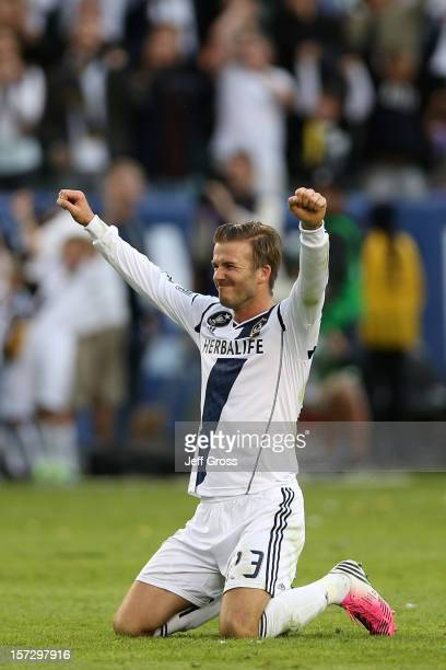 David Beckham of Los Angeles Galaxy celebrates in the second half against the Houston Dynamo in the 2012 MLS Cup at The Home Depot Center on December...