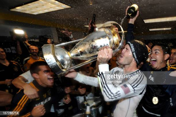 David Beckham of Los Angeles Galaxy drinks out of the MLS Trophy after the Galaxy defeat the Houston Dynamo 31 to win the 2012 MLS Cup at The Home...