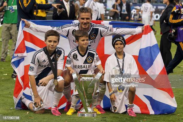 David Beckham of Los Angeles Galaxy poses with his sons Brooklyn Beckham Cruz Beckham and Romeo Beckham after the Galaxy defeat the Houston Dynamo 31...