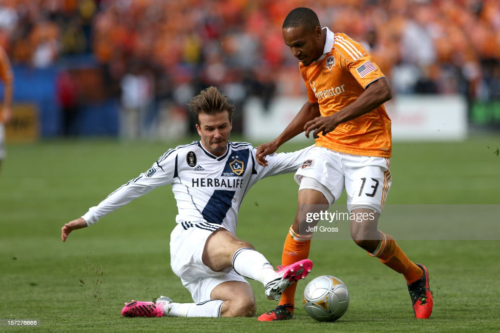David Beckham #23 of Los Angeles Galaxy slides for the ball against Ricardo Clark #13 of the Houston Dynamo in the first half in the 2012 MLS Cup at The Home Depot Center on December 1, 2012 in Carson, California.