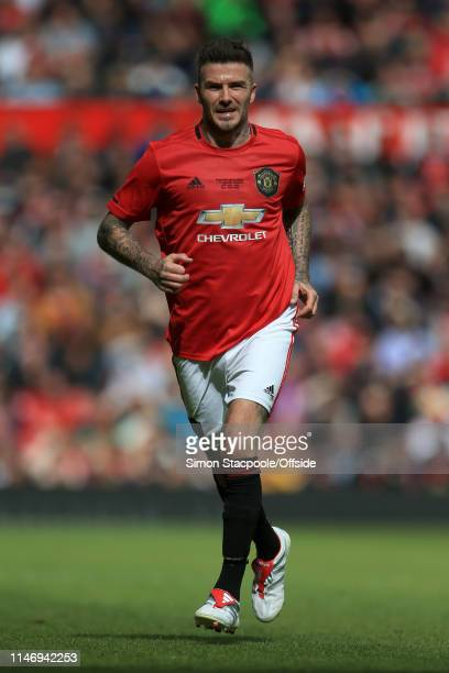 David Beckham of Man Utd in action during the Treble Reunion friendly match between the Manchester United '99 Legends and FC Bayern Legends at Old...