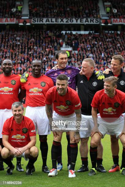 David Beckham of Man Utd jokes around before the Treble Reunion friendly match between the Manchester United '99 Legends and FC Bayern Legends at Old...