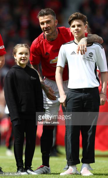 David Beckham of Manchester United '99 Legends pictured with his children Harper and Cruz during the Manchester United '99 Legends and FC Bayern...