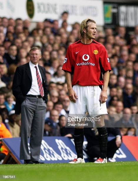 David Beckham of Manchester United and his manager Sir Alex Ferguson look in different directions during the FA Barclaycard Premiership match between...