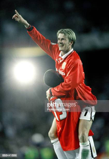 David Beckham of Manchester United being lifted by team mate Dwight Yorke while celebrating winning the UEFA Champions League Final between...
