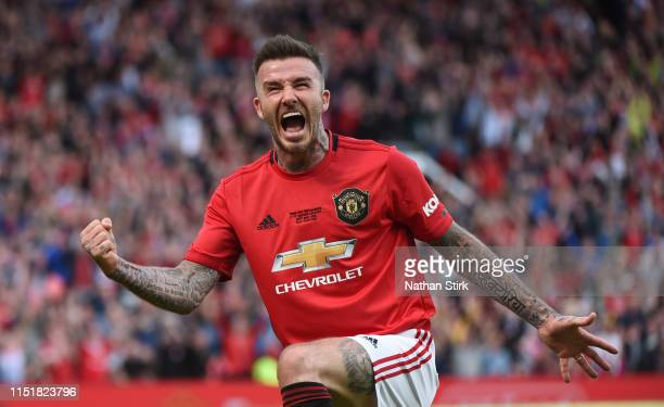 David Beckham of Manchester United celebrates after he scores in action during the Manchester United '99 Legends and FC Bayern Legends at Old...