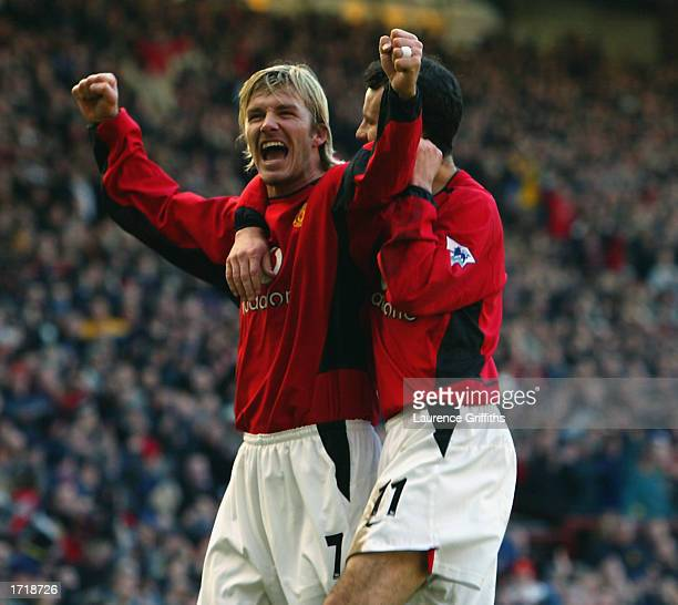 f054c838e71 David Beckham of Manchester United celebrates scoring his goal with teammate  Ryan Giggs during the FA