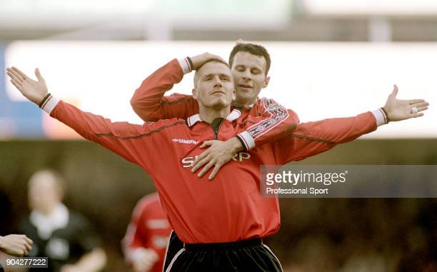 David Beckham of Manchester United celebrates with Ryan Giggs after scoring during the FA Carling Premiership match between Leicester City and...