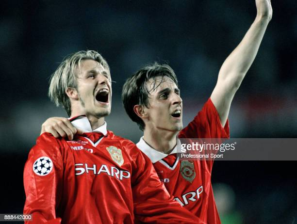 David Beckham of Manchester United celebrates with team mate Gary Neville after the final whistle of the UEFA Champions League Final between...