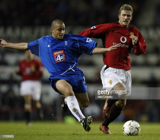 David Beckham of Manchester United challenges Curtis Woodhouse of Birmingham City during the FA Barclaycard Premiership match between Manchester...