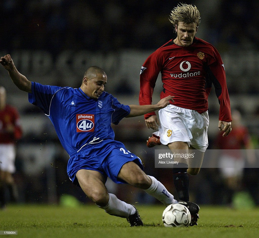 David Beckham of Manchester United challenges Curtis Woodhouse of Birmingham City during the FA Barclaycard Premiership match between Manchester United and Birmingham City at Old Trafford, on December 28, 2002 in Manchester, England. (Photo by Alex Livesey/Getty Images).