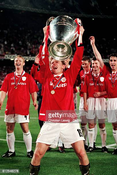 David Beckham of Manchester United holds the trophy after winning the 19971998 UEFA Champions League against Bayern Munich | Location Barcelona Spain