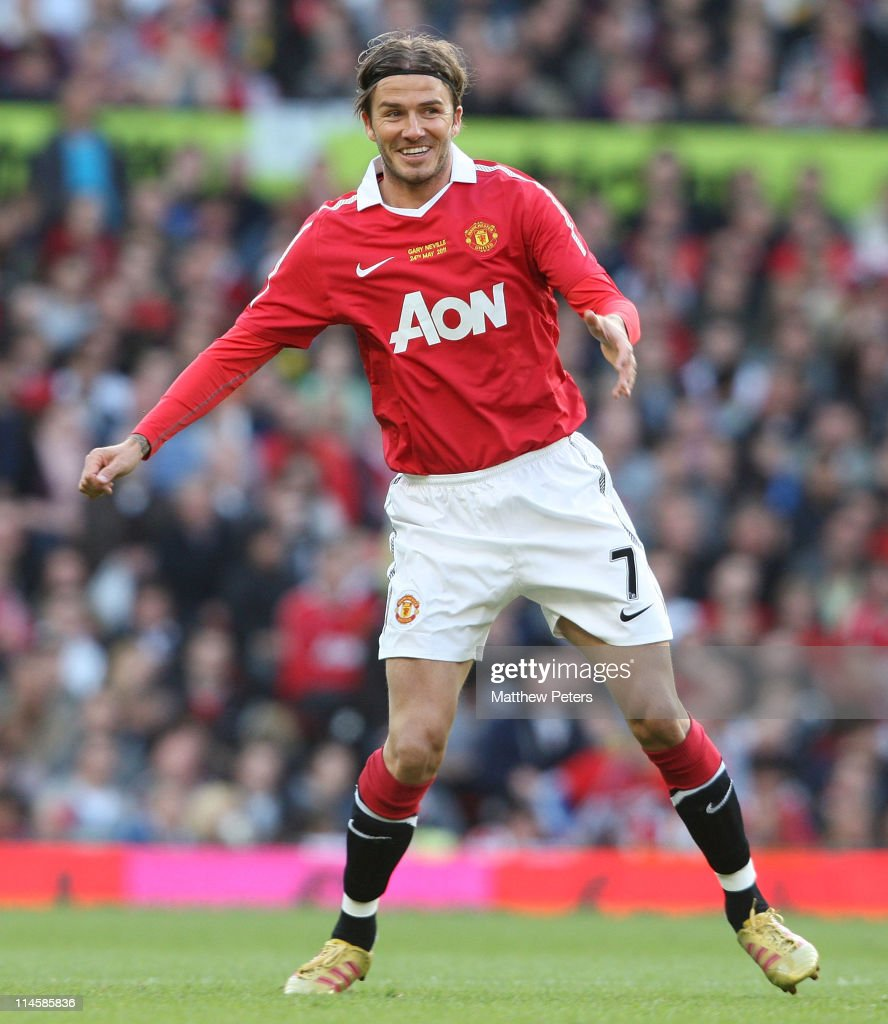 David Beckham of Manchester United in action during Gary Neville's testimonial match between Manchester United and Juventus at Old Trafford on May 24, 2011 in Manchester, England.