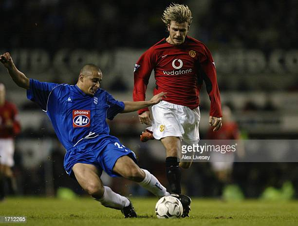 David Beckham of Manchester United is tackled by Curtis Woodhouse of Birmingham City during the FA Barclaycard Premiership match between Manchester...