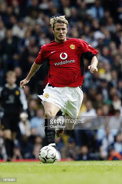 David Beckham of Manchester United running with the ball during the FA Barclaycard Premiership match between Tottenham Hotspur and Manchester United...