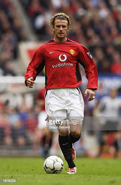 David Beckham of Manchester United runs with the ball during the FA Barclaycard Premiership match between Manchester United and Charlton Athletic...