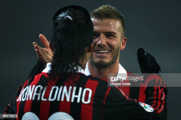David Beckham of Milan celebtates his sides first goal with Ronaldhino during the Juventus v AC Milan Serie A match at the Stadio Olimpico di Torino...