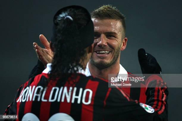David Beckham of Milan celebtates his sides first goal with Ronaldhino during the Juventus v AC Milan Serie A match at the Stadio Olimpico di Torino...