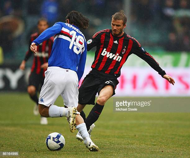 David Beckham of Milan challenges Daniele Franceschini during the Serie A match between Sampdoria and AC Milan at the Stadio Luigi Ferraris on March...