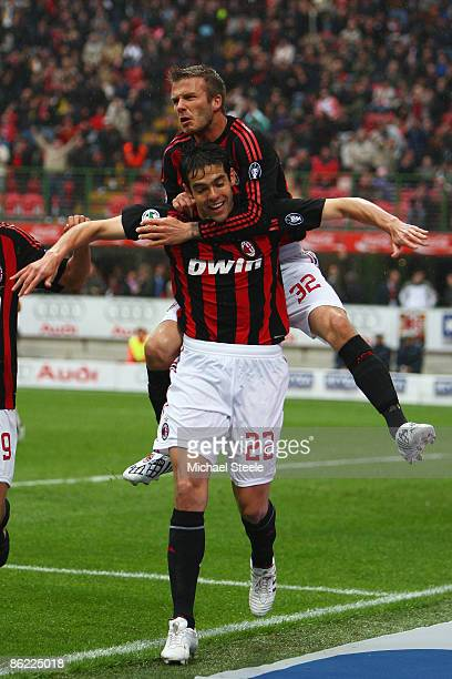 David Beckham of Milan jumps on the back of Kaka to celebrate the first goal during the Serie A match between AC Milan and US Citta di Palermo at the...