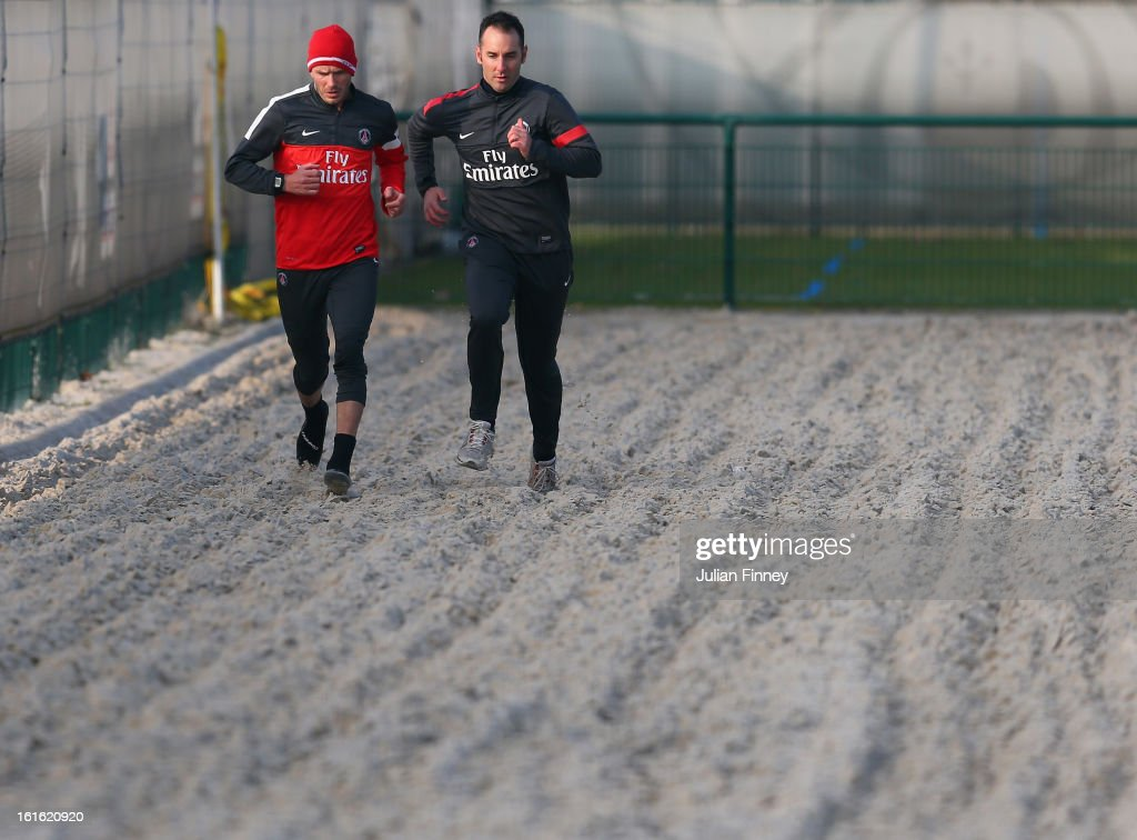 David Beckham of Paris Saint-Germain FC runs in sand as he attends his first training session on February 13, 2013 in Paris, France.