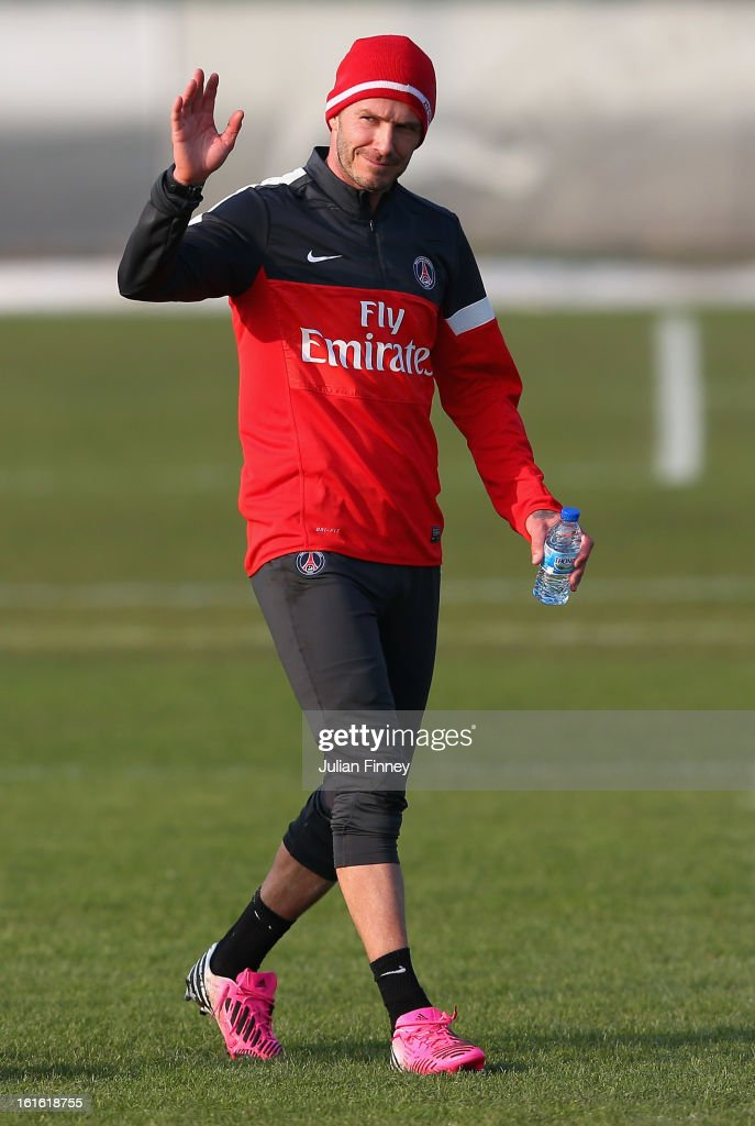 David Beckham of Paris Saint-Germain FC waves as he attends his first training session on February 13, 2013 in Paris, France.
