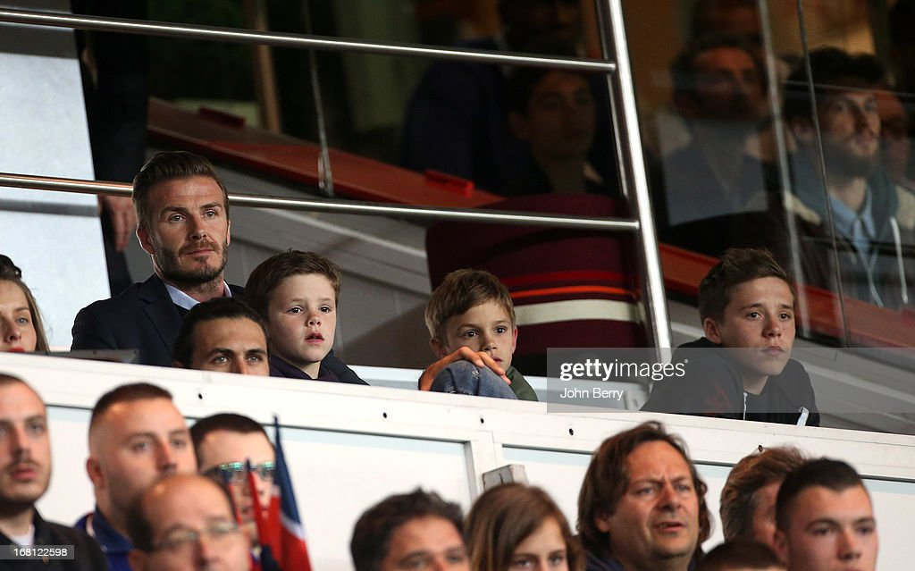 David Beckham of PSG and his 3 sons Cruz Beckham, Romeo Beckham and Brooklyn Beckham attend the Ligue 1 match between Paris Saint-Germain FC and Valenciennes FC at the Parc des Princes stadium on May 5, 2013 in Paris, France.