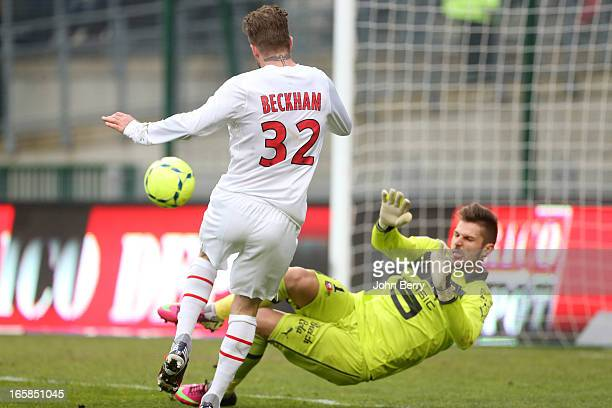 David Beckham of PSG attempts a shot at goal past Rennes goalkeeper Benoit Costil during the Ligue 1 match between Stade Rennais and Paris...