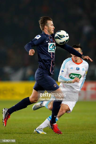 David Beckham of PSG controls the ball and gets past Joey Barton of Marseille during the French Cup match between Paris SaintGermain FC and Marseille...