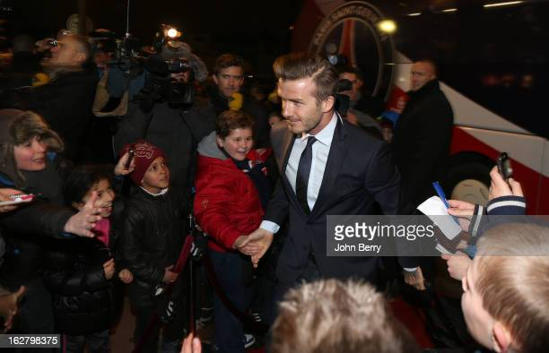 David Beckham of PSG greets fans as he arrives at the stadium ahead of the French Cup match between Paris Saint Germain FC and Olympique de Marseille...