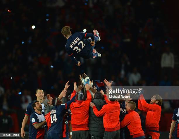 David Beckham of PSG is tossed in the air by team mates after the Ligue 1 match between Paris SaintGermain FC and Stade Brestois 29 at Parc des...