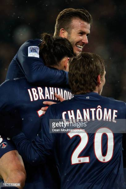 David Beckham of PSG jumps on the goal scorer and team mate Zlatan Ibrahimovic during the Ligue 1 match between Paris SaintGermain FC and Olympique...