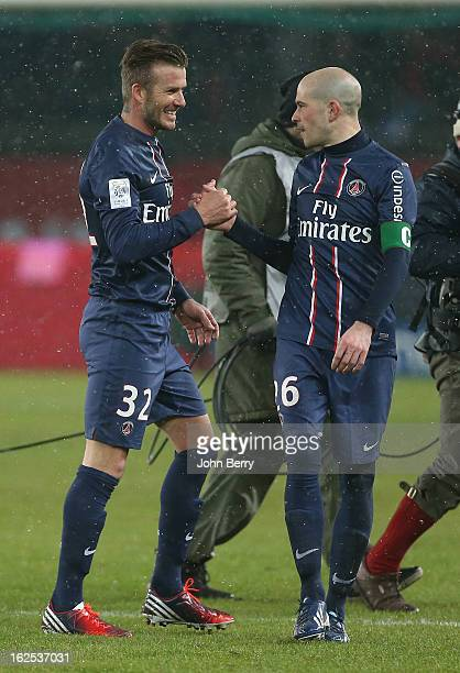David Beckham of PSG smiles with teammate Christophe Jallet after the French Ligue 1 match between Paris Saint Germain FC and Olympique de Marseille...