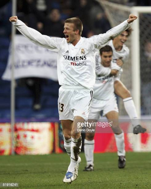 David Beckham of Real Madrid celebrates after his team beat Real Sociedad in their Primera Liga match at the Bernabeu on January 5 2005 in Madrid...